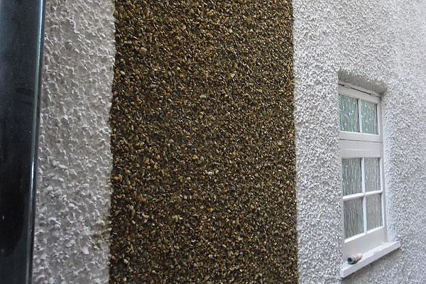 Pebble dashed wall