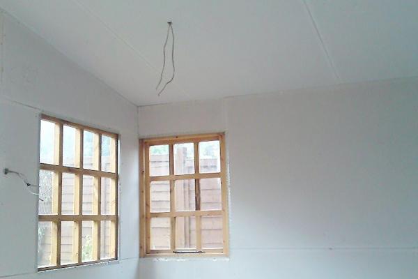 Plasterboarding walls