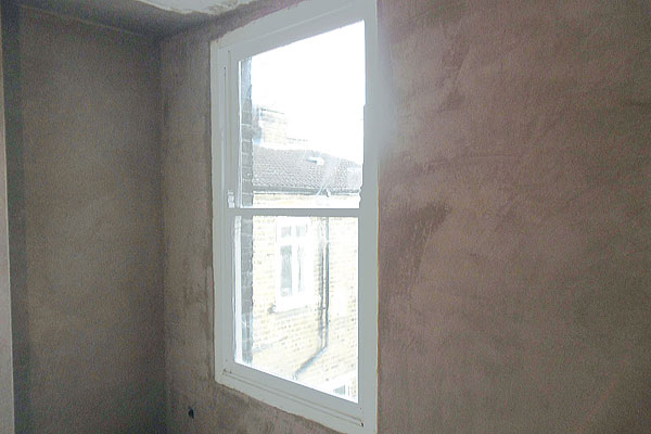 Plastering around a window