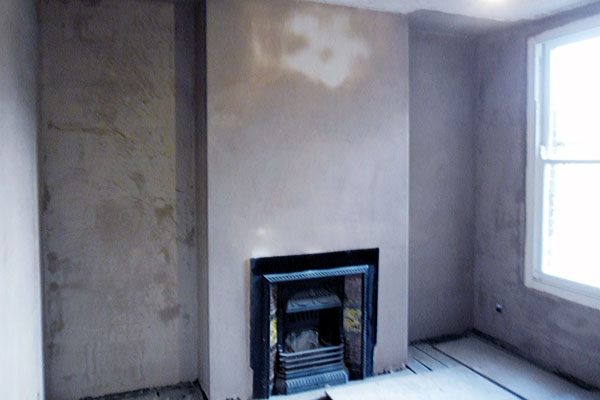 Plastering a fireplace